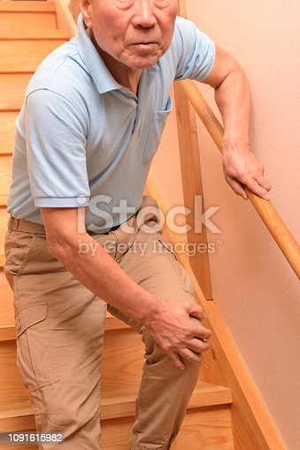 181879982istockphoto Senior climbs up stairs 1091615982