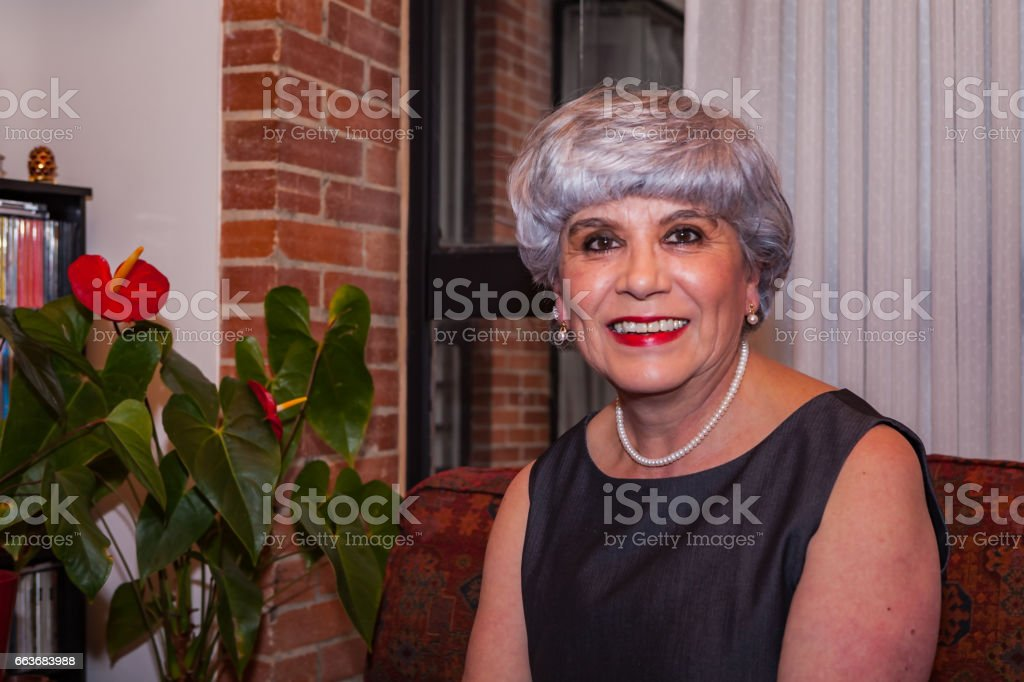 A Senior Colombian Lady at Home in Her Apartment stock photo