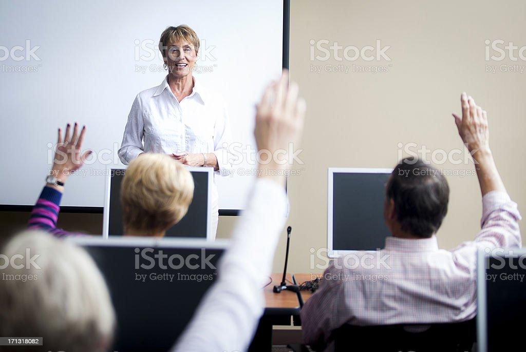 Senior Computer Class - Raising Hands royalty-free stock photo