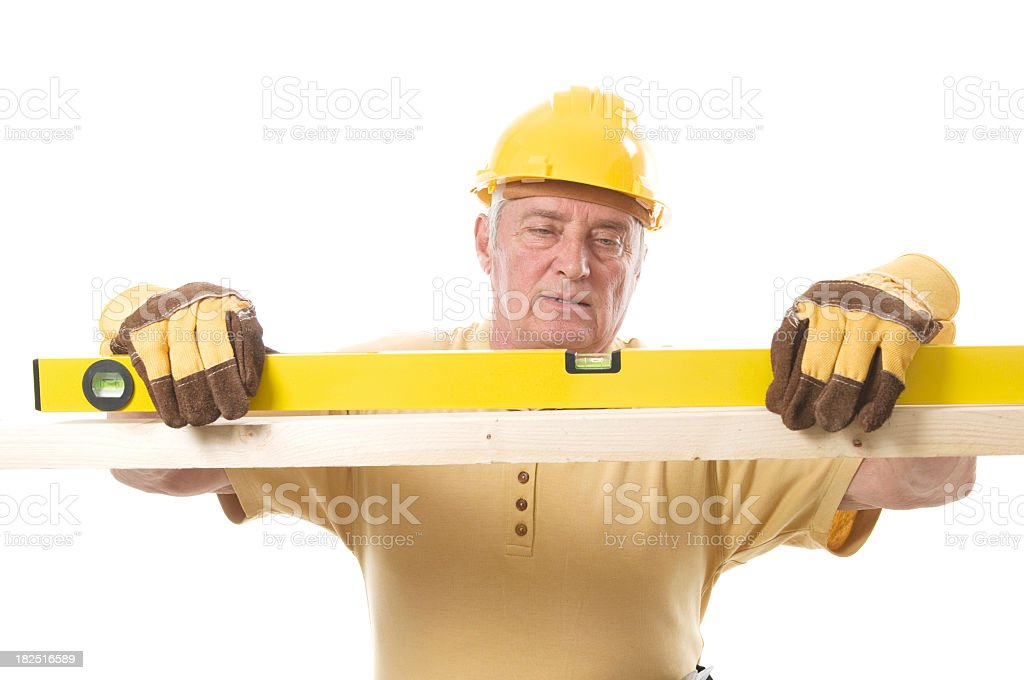 Senior constructor with level royalty-free stock photo