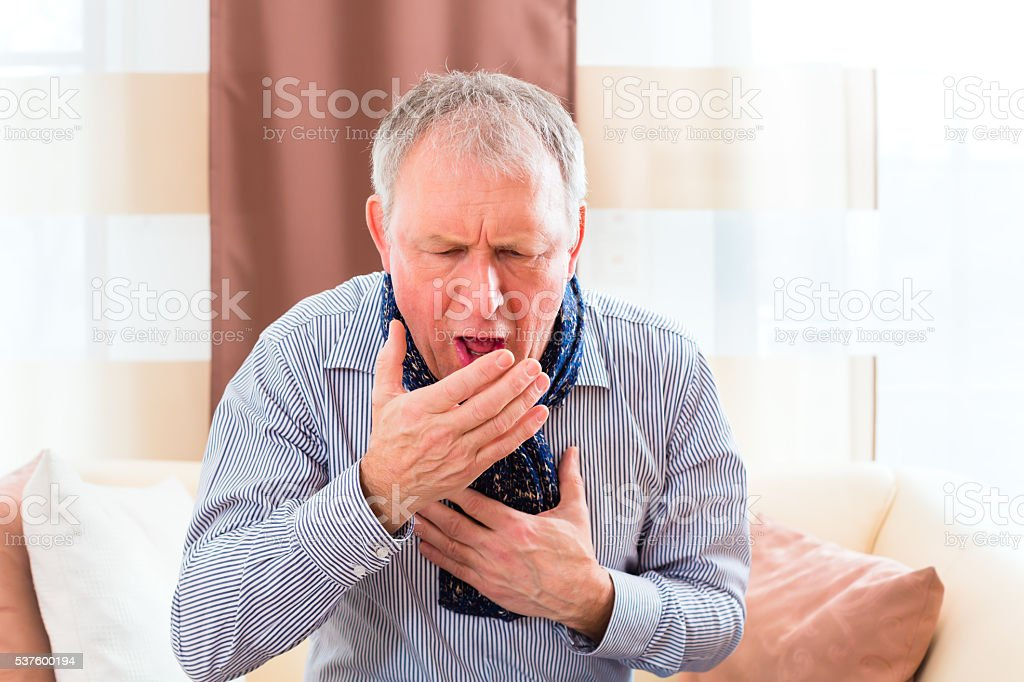 Senior coughing and having the flu stock photo