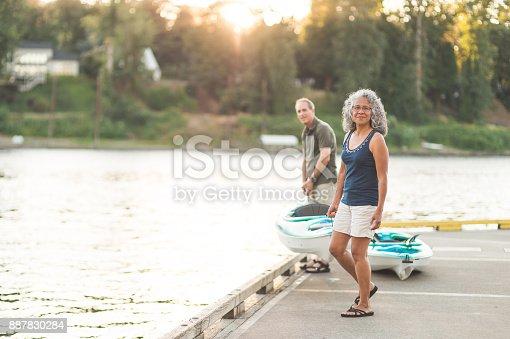 690538774istockphoto Senior couple about to go kayaking 887830284