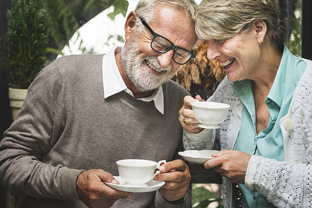 Senior Couple Afternoon Tea Drinking Relax Concept stock photo