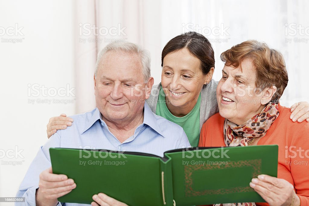 Senior couple and caregiver royalty-free stock photo