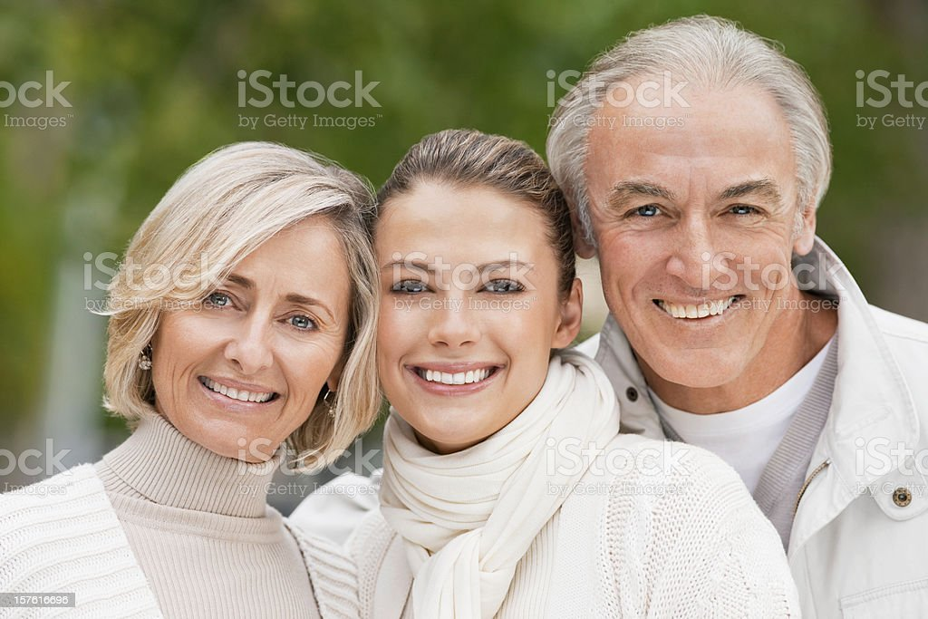 Senior Couple and Daughter Smiling royalty-free stock photo