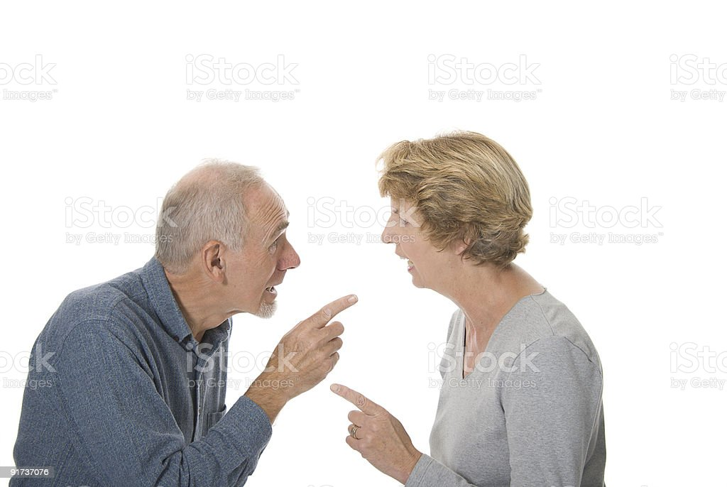 Senior couple arguing animatedly. royalty-free stock photo