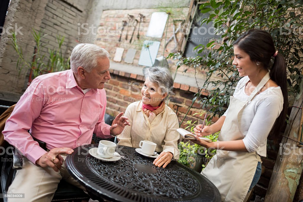 Senior couple at a cafe royalty-free stock photo
