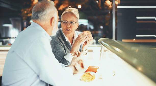 Senior couple at a diner. stock photo