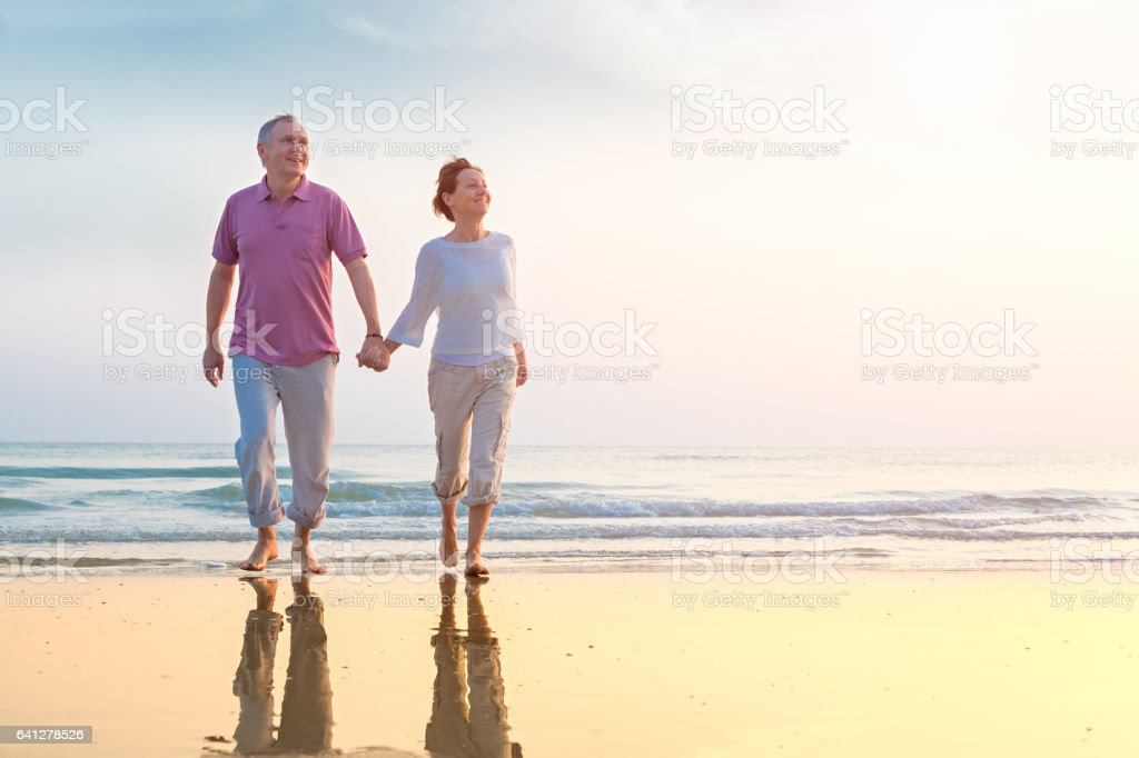 Senior couple at beach stock photo