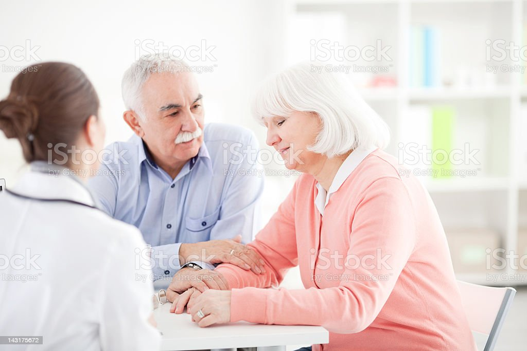 Senior couple at doctor's office stock photo