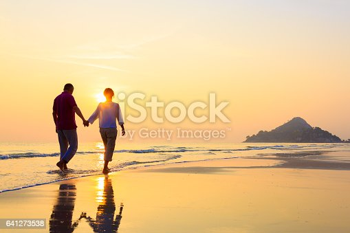 Senior couple at golden beach