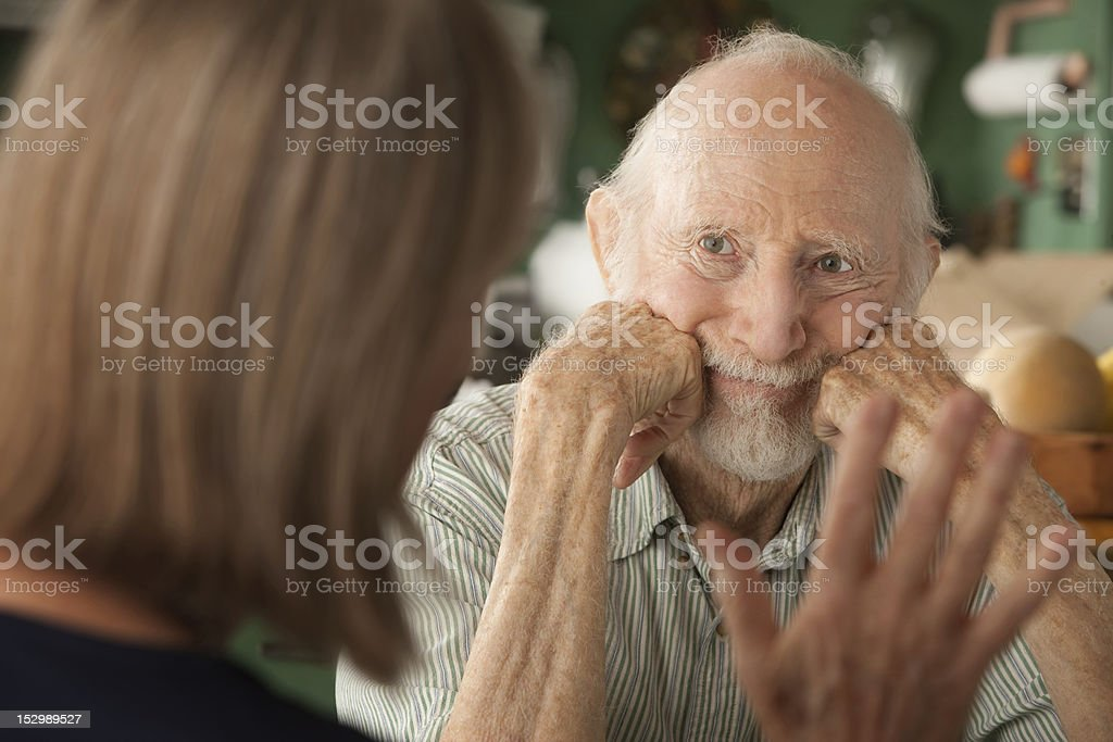 Senior couple at home focusing on angry man stock photo