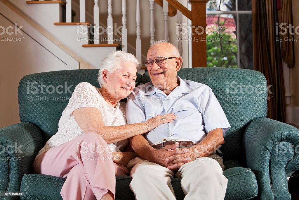 Senior couple at home laughing stock photo