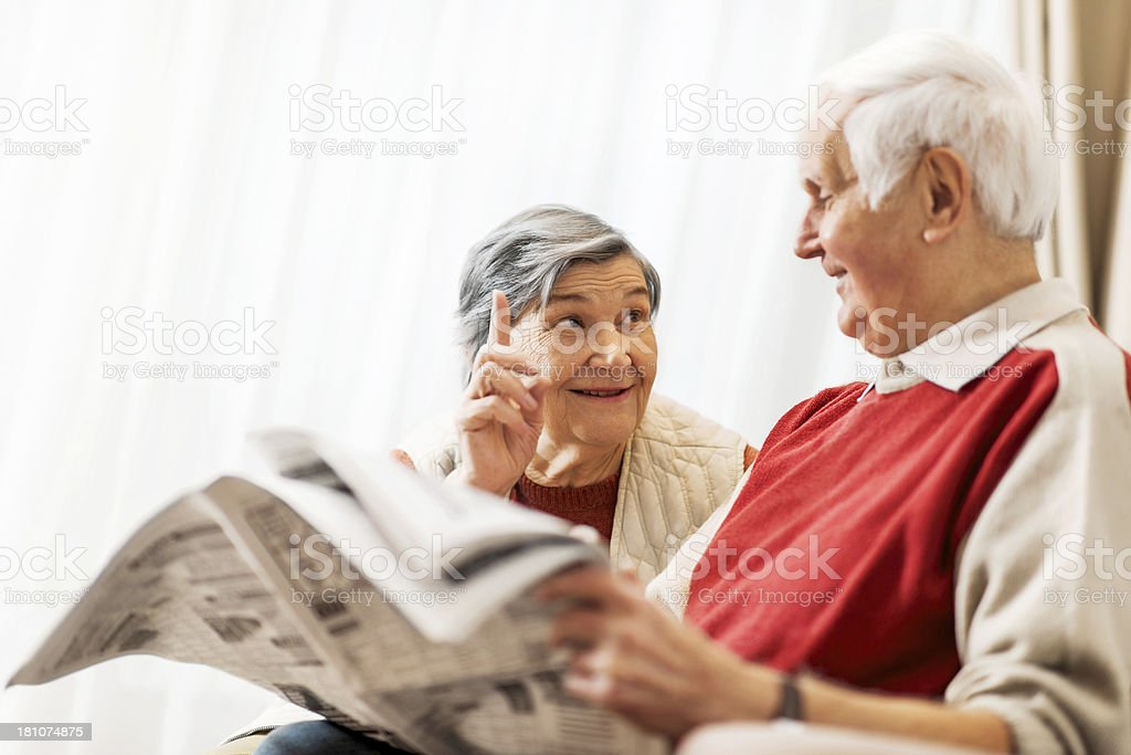 Senior couple at home reading newspaper. royalty-free stock photo