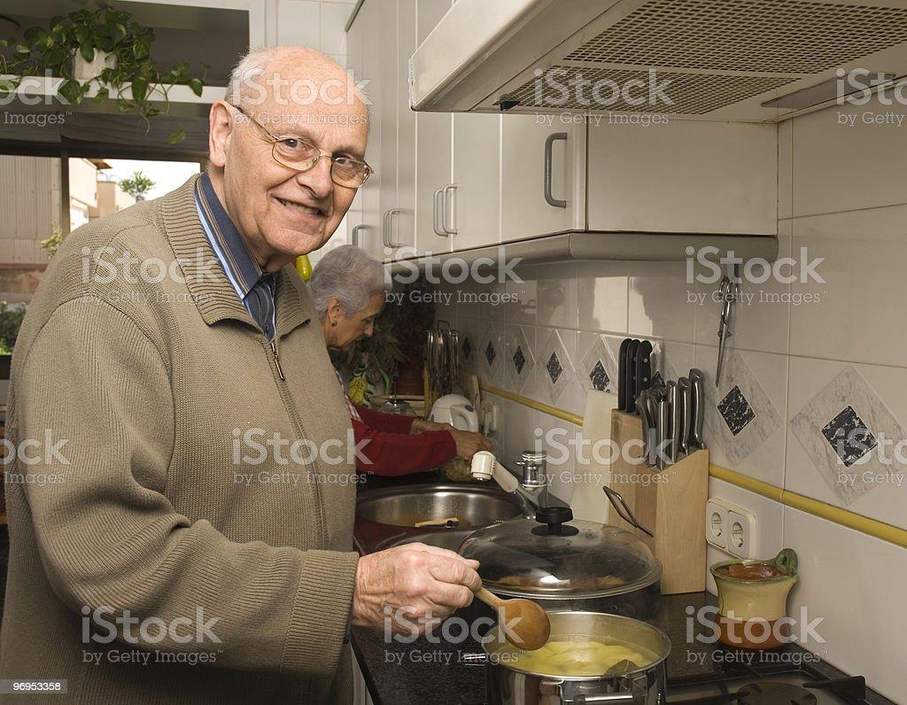 Senior couple at kitchen royalty-free stock photo