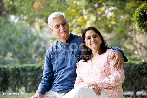 Senior couple spending leisure time at park