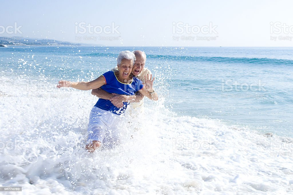 Senior couple at the beach royalty-free stock photo
