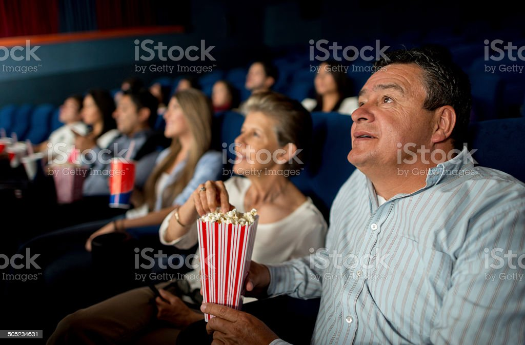Senior couple at the cinema stock photo