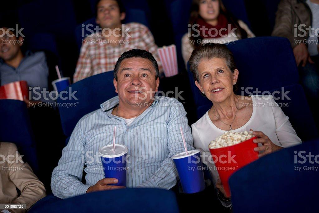 Senior couple at the movies stock photo