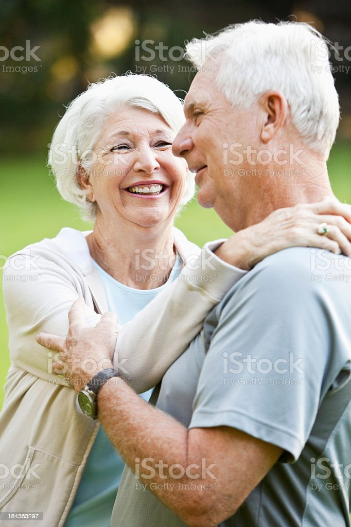 Senior couple at the park stock photo