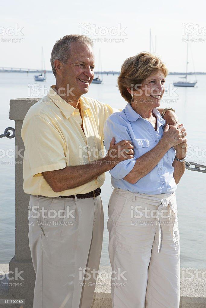 Senior couple at waterfront royalty-free stock photo