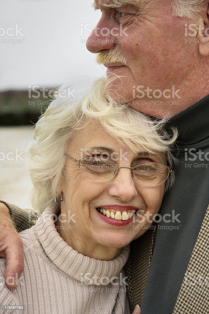Senior couple beach embrace - close royalty-free stock photo