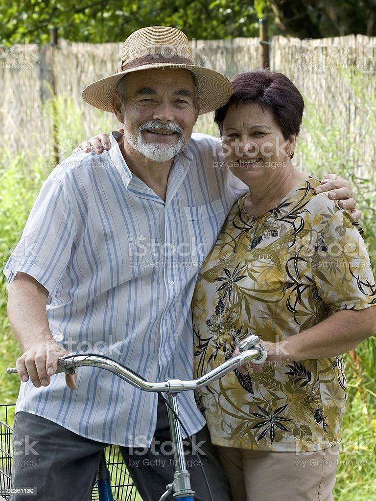 senior couple bicycling royalty-free stock photo