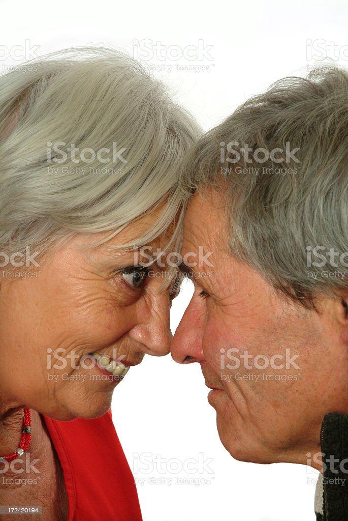 Senior couple bumping heads royalty-free stock photo