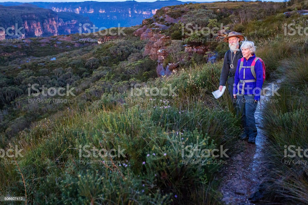Senior Couple Bushwalkers in the Bush With Pre Dawn Light stock photo