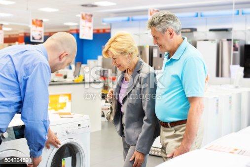 istock Senior couple buying a washing machine 504264891