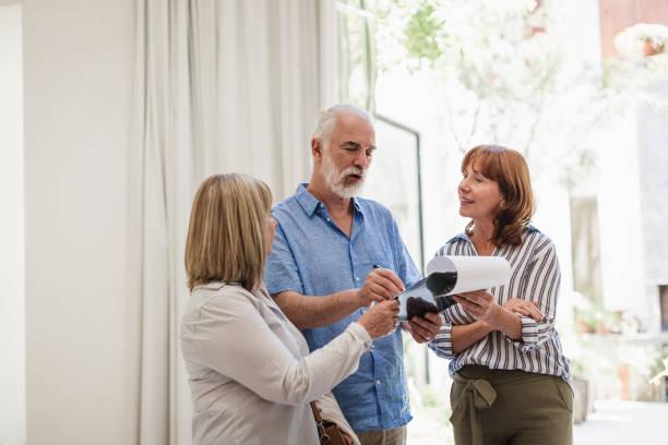 Senior couple buying new house stock photo