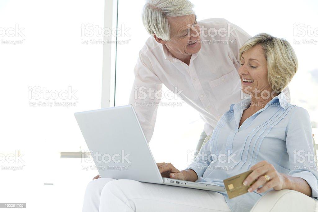 Senior couple buying on line stock photo