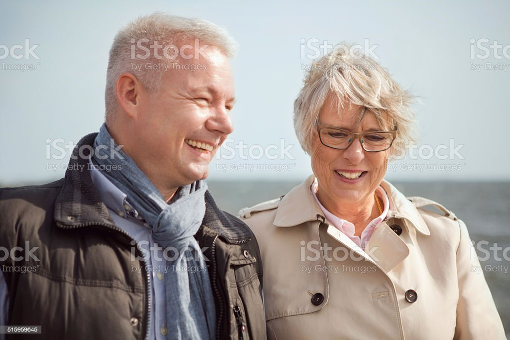Senior couple by the sea. stock photo