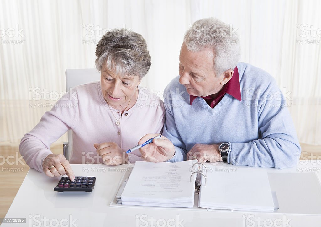 Senior Couple Calculating Budget royalty-free stock photo