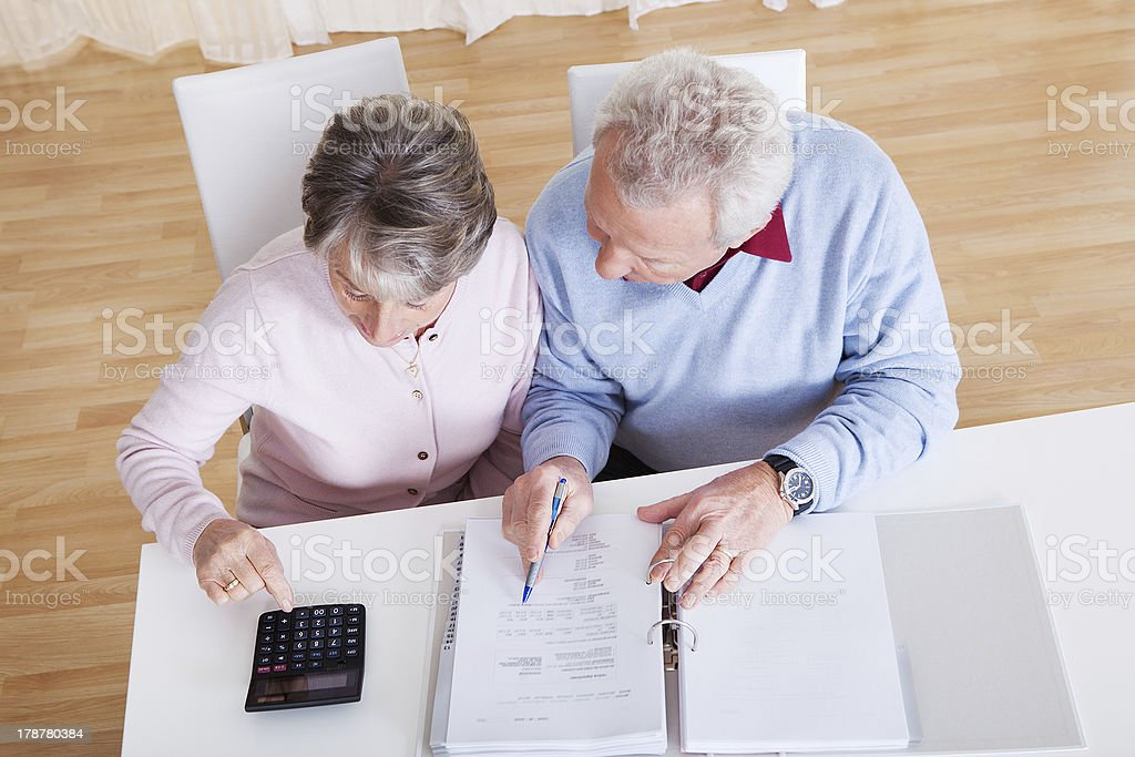 Senior Couple Calculating Budget stock photo