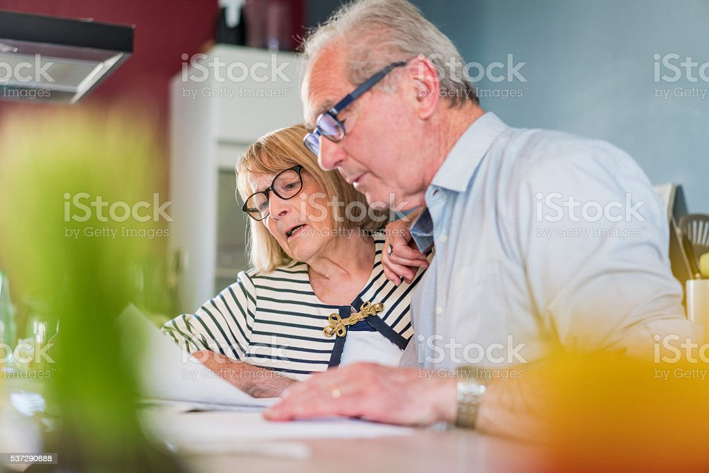 Senior couple calculating home finance stock photo