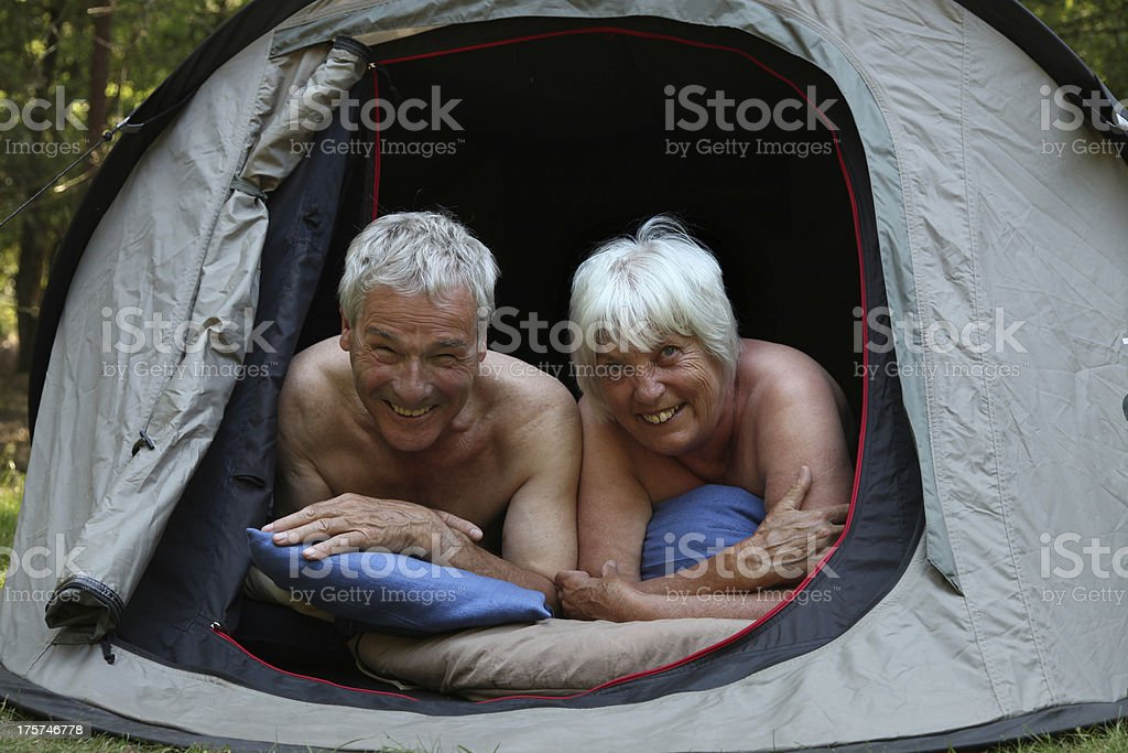 Senior Couple Camping in a Tent royalty-free stock photo