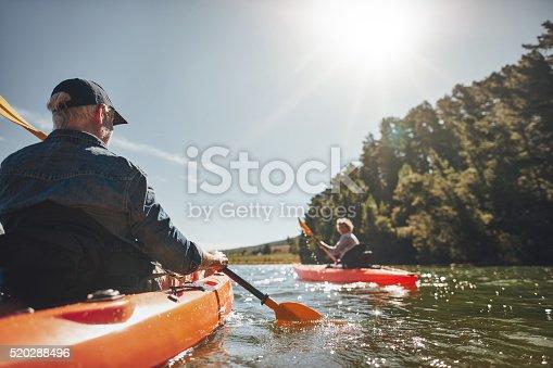 istock Senior couple canoeing in the lake 520288496