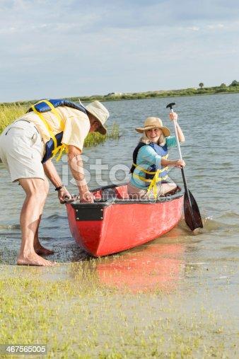 istock Senior couple canoeing on Intracoastal waterway, Florida 467565005