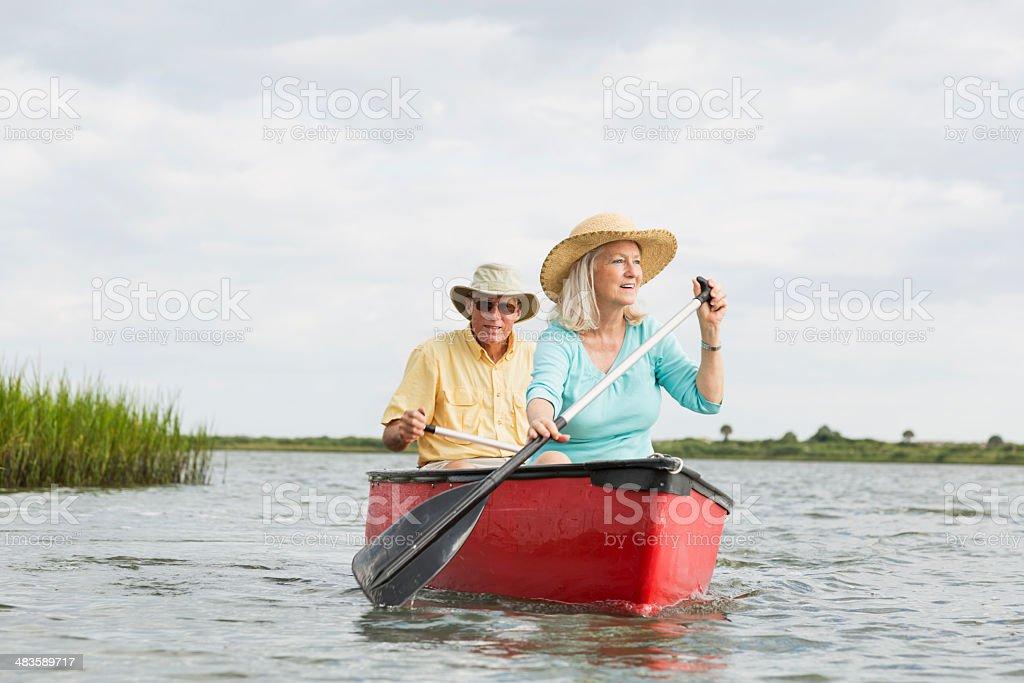 Senior couple canoeing on Intracoastal waterway, Florida stock photo
