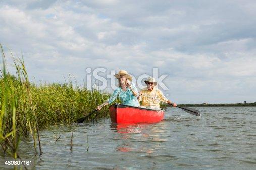 istock Senior couple canoeing 480607161
