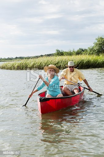 986720410 istock photo Senior couple canoeing together on Intracoastal waterway 465486157