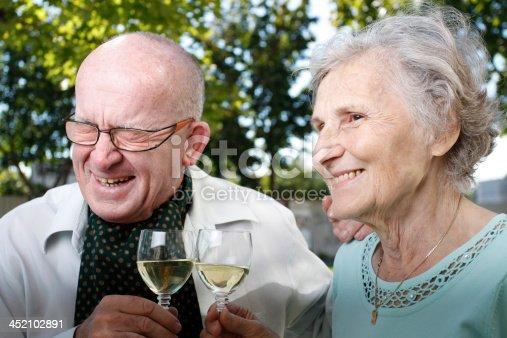 Older couple celebrates 50 year of marriage, laughing and enjoys life.