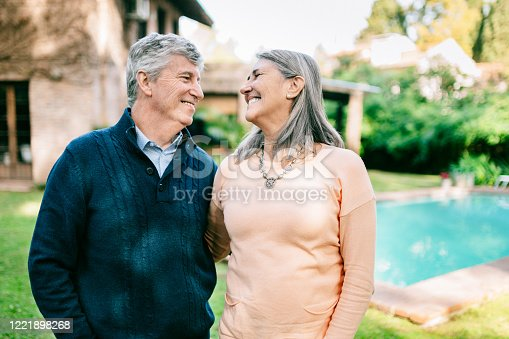 Senior couple celebrating life in the garden of their residence