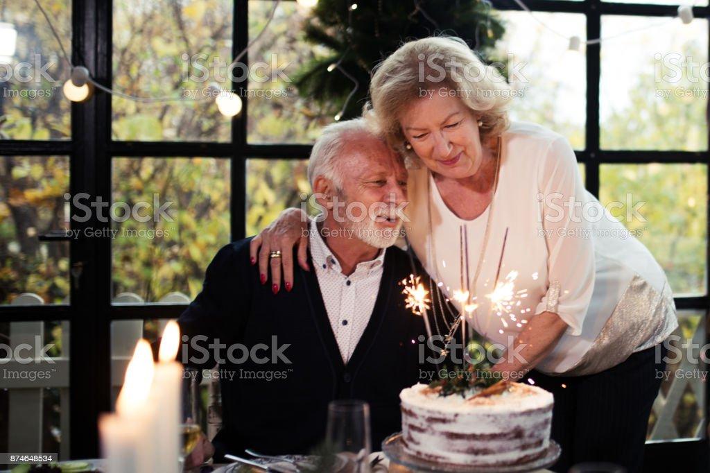 Senior couple celebrating stock photo