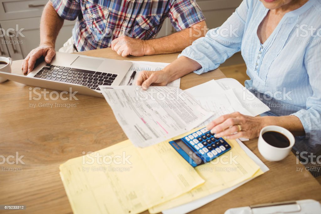 Senior couple checking their bills stock photo