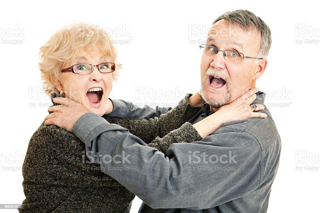 Senior couple choking each other royalty-free stock photo