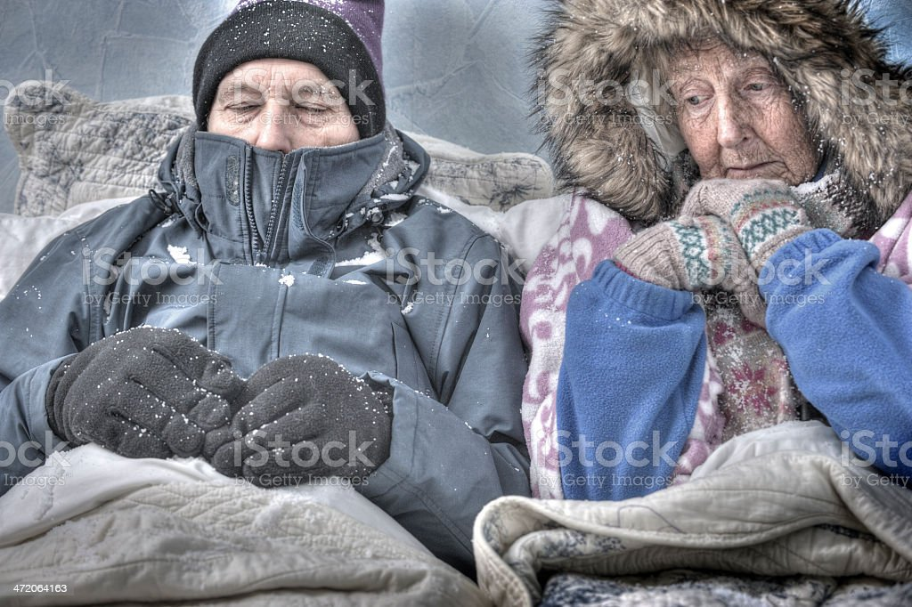 Senior couple, cold and miserable stock photo