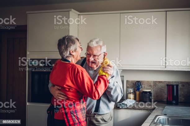 Senior couple dance in their kitcchen picture id665805328?b=1&k=6&m=665805328&s=612x612&h=zyokai1qp90gfamer18zegurvgwahnpjugk xystfvk=