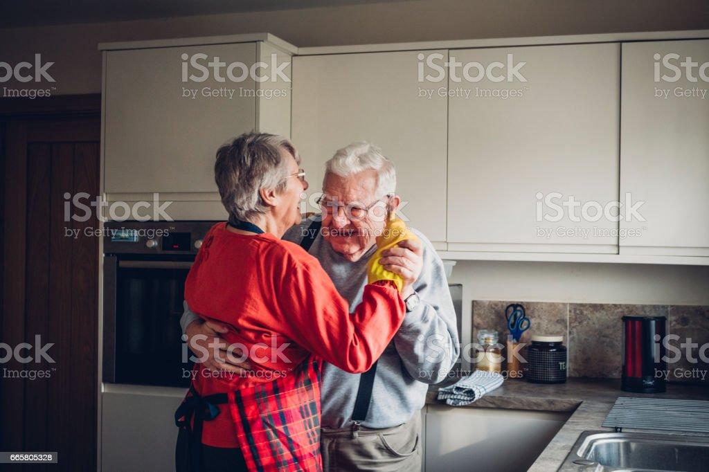 Senior Couple Dance in their Kitcchen stock photo